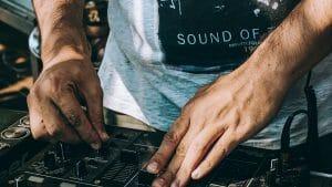 DJ adjusting knobs